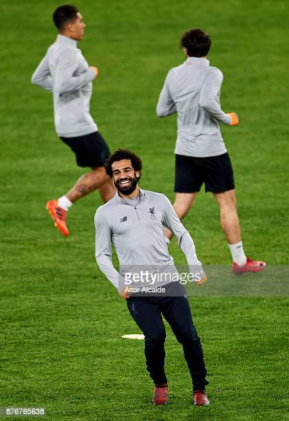 Mohamed Salah Liverpool FC looks on during the training session prior to their Champions League match against Liverpool FC at Estadio Ramon SAnchez...