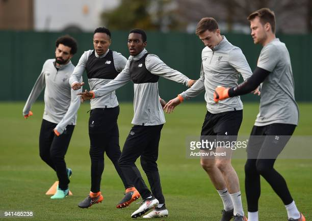 Mohamed Salah Nathaniel Clyne Rafael Camachoand Simon Mignolet of Liverpool during a training session at Melwood Training Ground on April 3 2018 in...