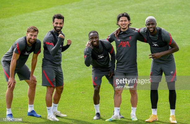 Mohamed Salah Nathaniel Phillips Naby Keita Takumi Minamino and Divock Origi of Liverpool in action action during a training session at Melwood...