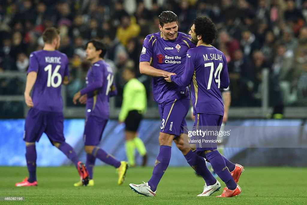 Mohamed Salah (R) of ACF Fiorentina celebrates the opening goal with team mate Mario Gomez during the TIM Cup match between Juventus FC and ACF Fiorentina at Juventus Arena on March 5, 2015 in Turin, Italy.