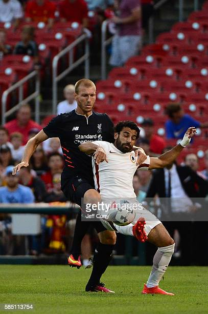 Mohamed Salah of AS Roma and Ragnar Klavan of Liverpool FC battle for the ball during a friendly match at Busch Stadium on August 1 2016 in St Louis...
