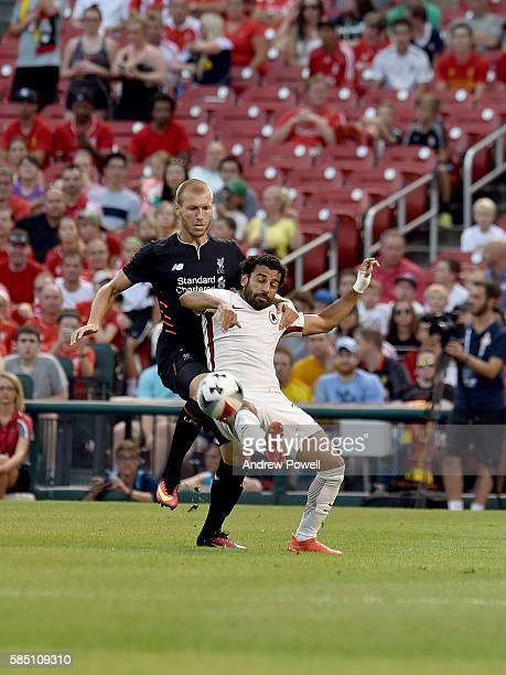 Mohamed Salah of AS Roma and Ragner Klavan of Liverpool FC vie for control of the ball during a preseason friendly at Busch Stadium on August 1 2016...