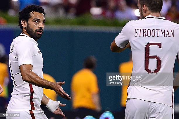 Mohamed Salah of AS Roma celebrates with Kevin Strootman after scoring the game winning goal against Liverpool FC during a friendly match at Busch...