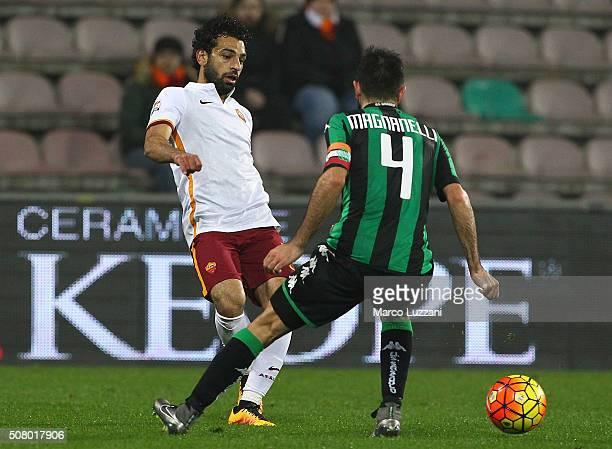 Mohamed Salah of AS Roma is challenged by Francesco Magnanelli of US Sassuolo Calcio during the Serie A match between US Sassuolo Calcio and AS Roma...