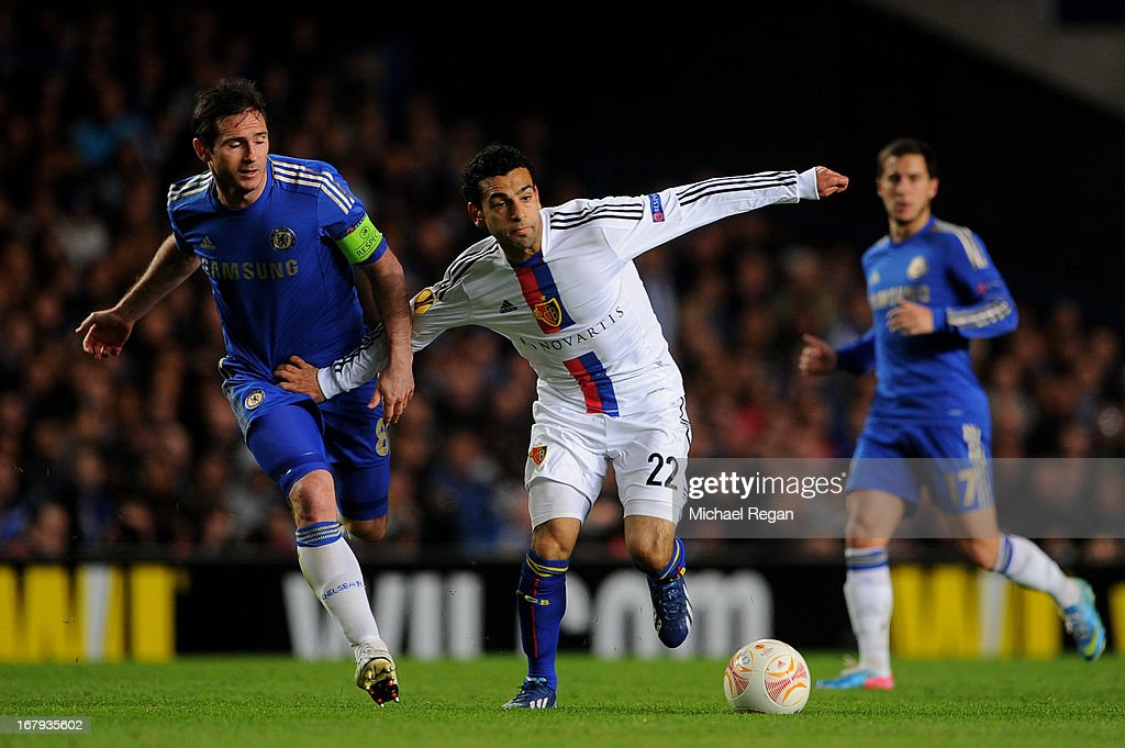 Mohamed Salah of Basel holds off Frank Lampard of Chelsea during UEFA Europa League semi final second leg match between Chelsea and FC Basel 1893 at Stamford Bridge on May 2, 2013 in London, England.
