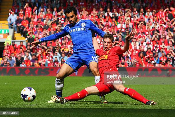 Mohamed Salah of Chelsea is tackled by Jon Flanagan of Liverpool during the Barclays Premier League match between Liverpool and Chelsea at Anfield on...
