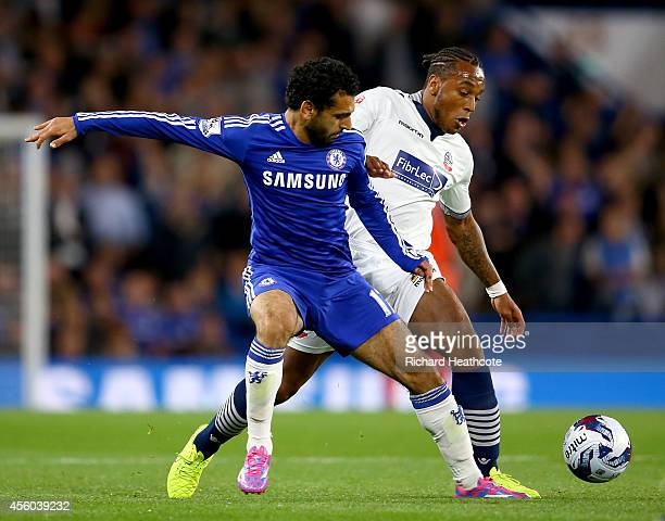 Mohamed Salah of Chelsea is tackled by Neil Danns of Bolton during the Captial One Cup Third Round match between Chelsea and Bolton Wanderers at...