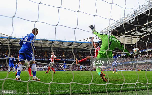 Mohamed Salah of Chelsea scores the opening goal past Asmir Begovic of Stoke City during the Barclays Premier League match between Chelsea and Stoke...