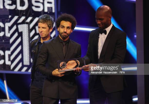 Mohamed Salah of Egypt and Liverpool receives FIFA Puskas Award from Noel Gallagher and Didier Drogba during The Best FIFA Football Awards at Royal...