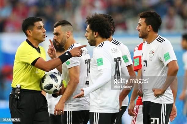 Mohamed Salah of Egypt argues with Referee Enrique Caceres during the 2018 FIFA World Cup Russia group A match between Russia and Egypt at Saint...