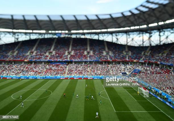 Mohamed Salah of Egypt breaks past Salman Alfaraj Hussain Almoqahwi and Motaz Hawsawi of Saudi Arabia during the 2018 FIFA World Cup Russia group A...