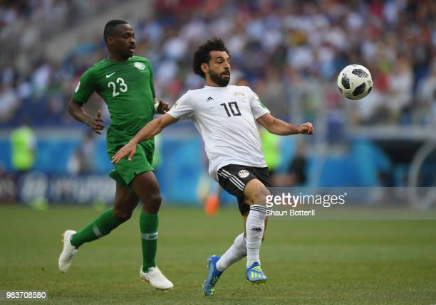 Mohamed Salah of Egypt breaks through to score his team's first goal during the 2018 FIFA World Cup Russia group A match between Saudia Arabia and...