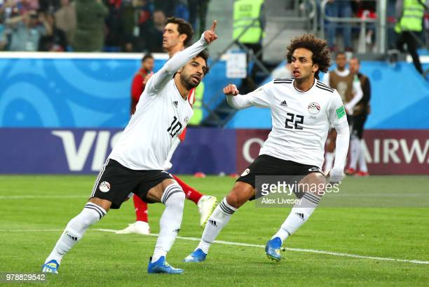 Mohamed Salah of Egypt celebrates after scoring a penalty for his team's first goal during the 2018 FIFA World Cup Russia group A match between...