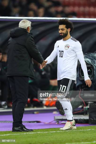 Mohamed Salah of Egypt celebrates with Hector Cuper head coach / manager of Egypt as he is substituted off during the International Friendly match...