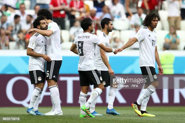Mohamed Salah of Egypt celebrates with teammate Ahmed Hegazy after scoring his team's first goal during the 2018 FIFA World Cup Russia group A match...