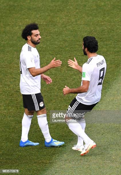Mohamed Salah of Egypt celebrates with teammate Marwan Mohsen after scoring his team's first goal during the 2018 FIFA World Cup Russia group A match...