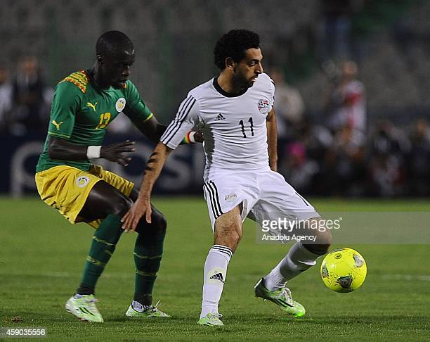 Mohamed Salah of Egypt in action against Idrissa Gueye of Senegal during the Africa Cup of Nations qualification group G match between Egypt and...