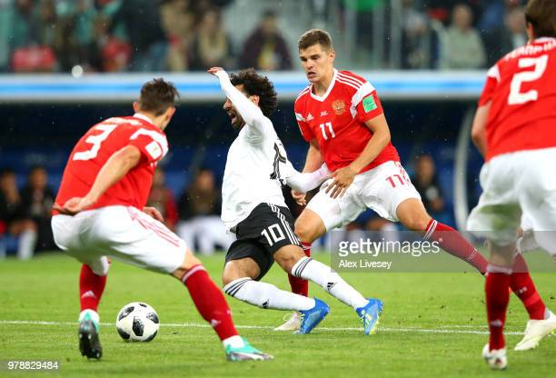 Mohamed Salah of Egypt is fouled by Roman Zobnin of Russia which after consulting VAR a penalty is awarded to Egypt during the 2018 FIFA World Cup...