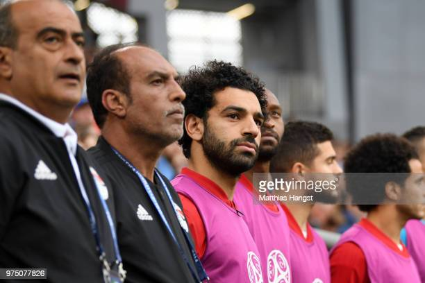 Mohamed Salah of Egypt looks on from the bench during the natonal anthems prior to the 2018 FIFA World Cup Russia group A match between Egypt and...