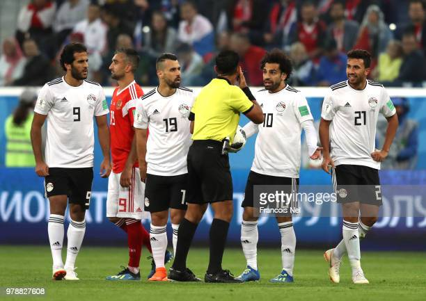 Mohamed Salah of Egypt qrgues with Referee Enrique Caceres during the 2018 FIFA World Cup Russia group A match between Russia and Egypt at Saint...