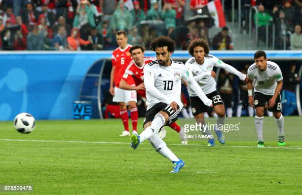 Mohamed Salah of Egypt scores his team's first goal from the penalty spot during the 2018 FIFA World Cup Russia group A match between Russia and...