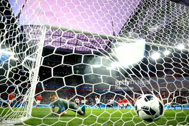 Mohamed Salah of Egypt scores his team's first goal from the penalty spot past Igor Akinfeev of Russia during the 2018 FIFA World Cup Russia group A...