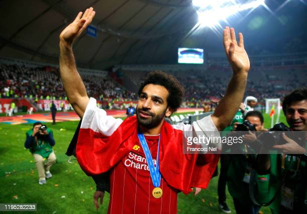 Mohamed Salah of Liverpool acknowledges fans after his team's victory in the FIFA Club World Cup Qatar 2019 Final between Liverpool FC and CR...