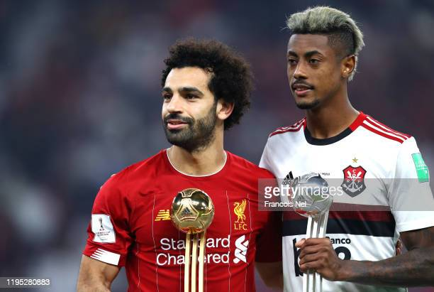 Mohamed Salah of Liverpool Adidas Golden Ball and Bruno Henrique of CR Flamengo Adidas Silver Ball pose with their respective trophies following the...