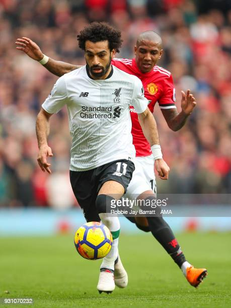 Mohamed Salah of Liverpool and Ashley Young of Manchester United during the Premier League match between Manchester United and Liverpool at Old...