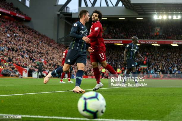 Mohamed Salah of Liverpool and Aymeric Laporte of Manchester City during the Premier League match between Liverpool FC and Manchester City at Anfield...