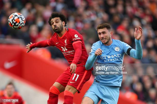 Mohamed Salah of Liverpool and Aymeric Laporte of Manchester City during the Premier League match between Liverpool and Manchester City at Anfield on...