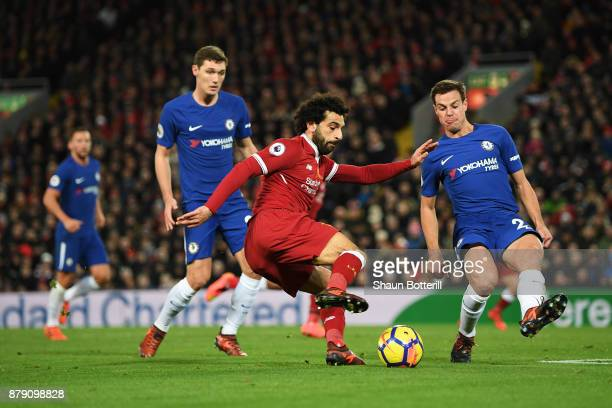 Mohamed Salah of Liverpool and Cesar Azpilicueta of Chelsea in action during the Premier League match between Liverpool and Chelsea at Anfield on...