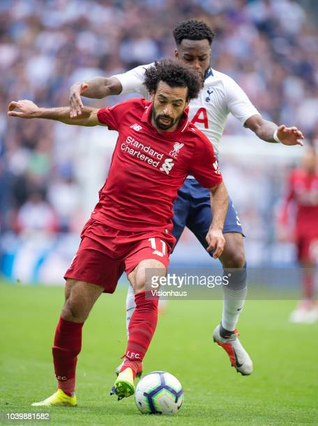 Mohamed Salah of Liverpool and Danny Rose of Tottenham Hotspur during the Premier League match between Tottenham Hotspur and Liverpool FC at Wembley...