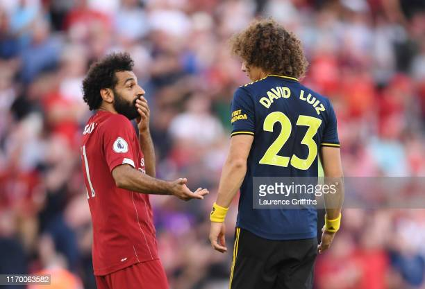 Mohamed Salah of Liverpool and David Luiz of Arsenal have a discussion after during the Premier League match between Liverpool FC and Arsenal FC at...