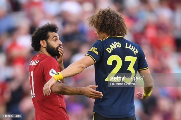 Mohamed Salah of Liverpool and David Luiz of Arsenal talk after the Premier League match between Liverpool FC and Arsenal FC at Anfield on August 24...