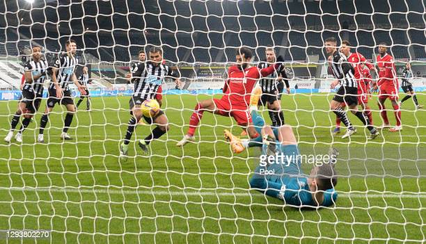 Mohamed Salah of Liverpool and DeAndre Yedlin of Newcastle United stretch for the ball during the Premier League match between Newcastle United and...
