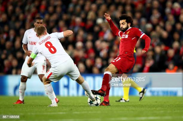 Mohamed Salah of Liverpool and Denis Glushakov of Spartak Moskva in action during the UEFA Champions League group E match between Liverpool FC and...