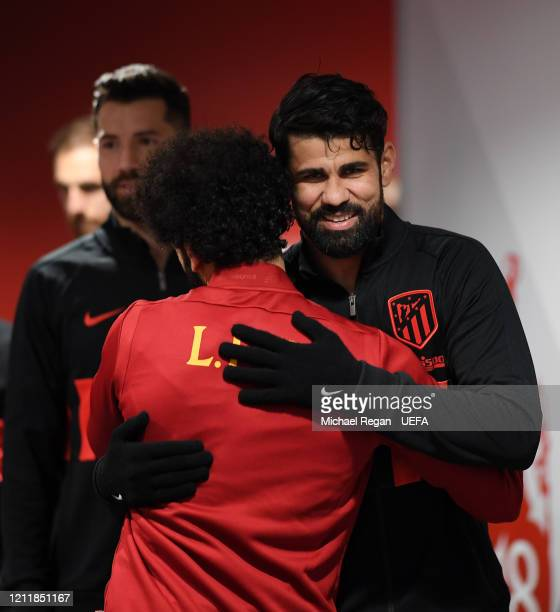 Mohamed Salah of Liverpool and Diego Costa of Atletico Madrid embrace in the tunnel prior to the UEFA Champions League round of 16 second leg match...