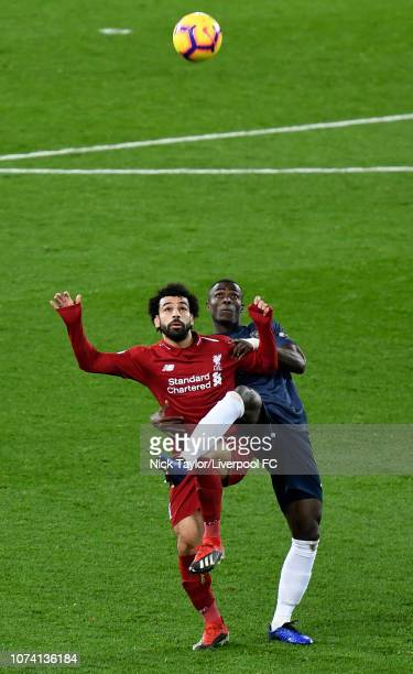 Mohamed Salah of Liverpool and Eric Bailly of Manchester United in action during the Premier League match between Liverpool FC and Manchester United...