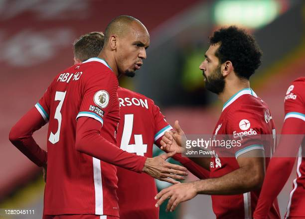 Mohamed Salah of Liverpool and Fabinho of Liverpool during the Premier League match between Liverpool and Sheffield United at Anfield on October 24,...