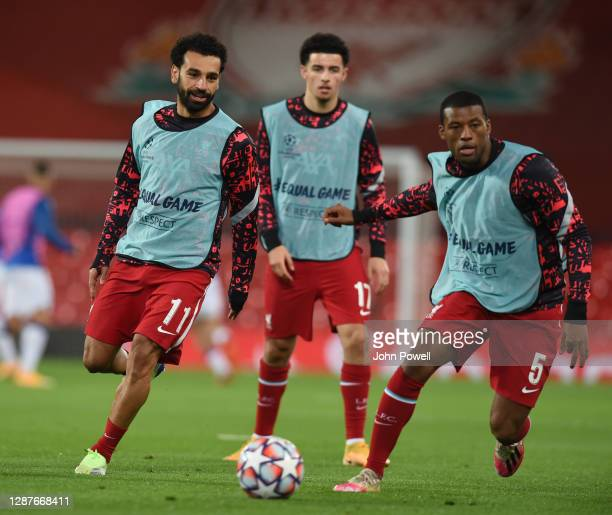 Mohamed Salah of Liverpool and Georginio Wijnaldum of Liverpool during the UEFA Champions League Group D stage match between Liverpool FC and...
