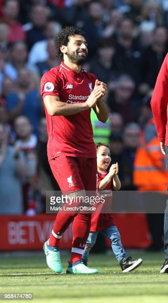 Mohamed Salah of Liverpool and his daughter Makka during the Premier League match between Liverpool and Brighton and Hove Albion at Anfield on May 13...