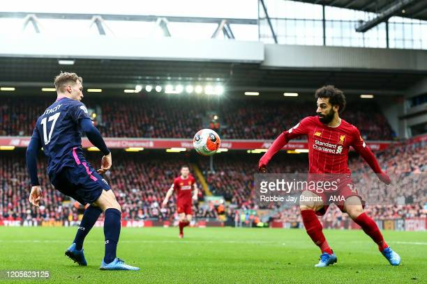 Mohamed Salah of Liverpool and Jack Stacey of Bournemouth during the Premier League match between Liverpool FC and AFC Bournemouth at Anfield on...