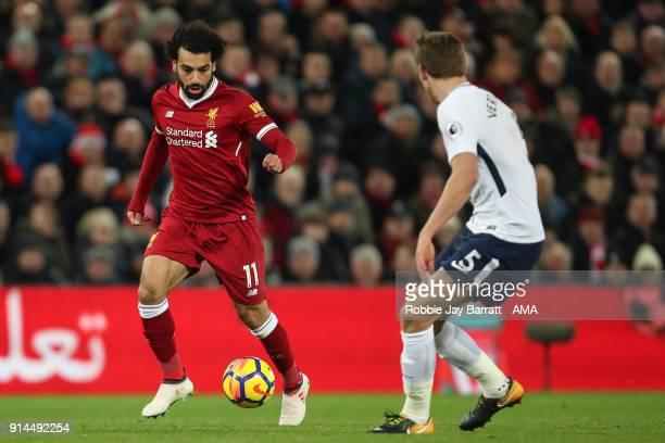 Mohamed Salah of Liverpool and Jan Vertongen of Tottenham Hotspur during the Premier League match between Liverpool and Tottenham Hotspur at Anfield...