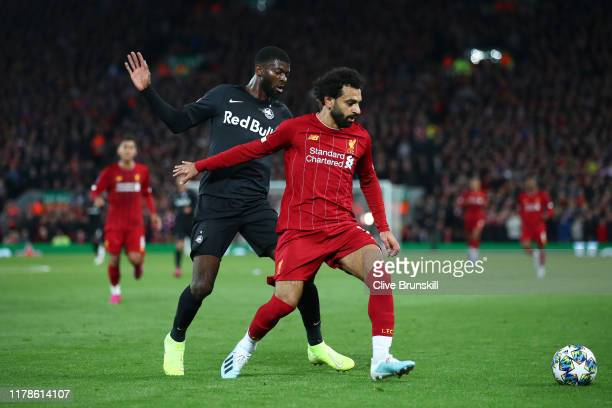 Mohamed Salah of Liverpool and Jerome Onguene of Red Bull Salzburg during the UEFA Champions League group E match between Liverpool FC and RB...