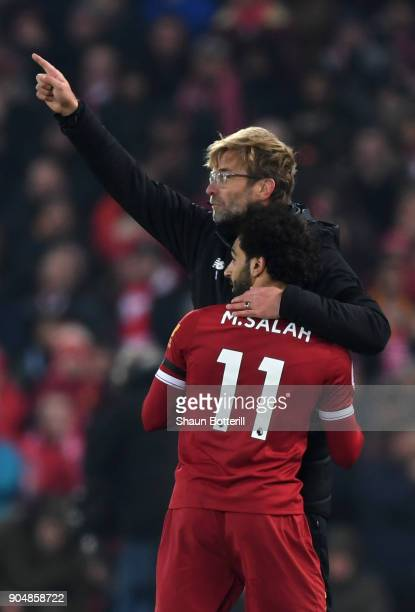 Mohamed Salah of Liverpool and Jurgen Klopp Manager of Liverpool hug when Mohamed Salah is being substituted during the Premier League match between...