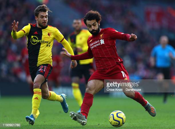 Mohamed Salah of Liverpool and Kiko Femenia of Watford FC in action during the Premier League match between Liverpool FC and Watford FC at Anfield on...