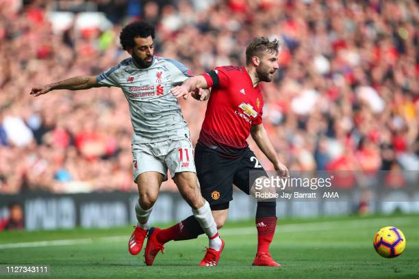 Mohamed Salah of Liverpool and Luke Shaw of Manchester United during the Premier League match between Manchester United and Liverpool FC at Old...