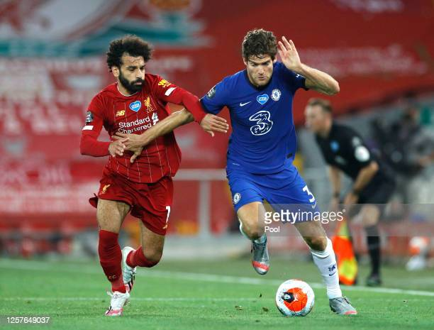 Mohamed Salah of Liverpool and Marcos Alonso of Chelsea battle for the ball during the Premier League match between Liverpool FC and Chelsea FC at...
