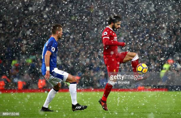 Mohamed Salah of Liverpool and Morgan Schneiderlin of Everton in action during the Premier League match between Liverpool and Everton at Anfield on...